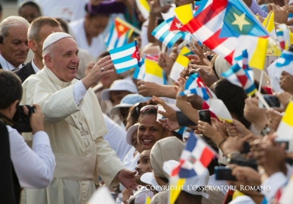 Pope Francis waves to Cubans at the mass