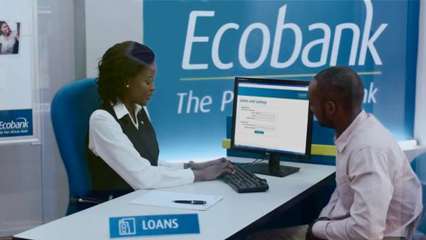 EcoBank staff expalins a point
