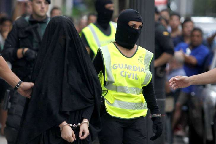 A Moroccan woman suspected of recruiting other women to join the Islamic State, also known as ISIS or ISIL, was arrested by Spanish police on Sept. 5, 2015. Photo Credit: AFP