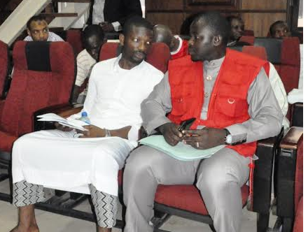 Kekere-Ekun with EFCC operative, during extradition hearing in Nigeria