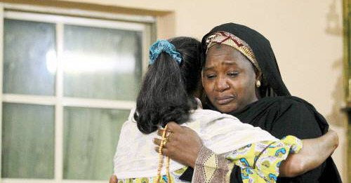 2 female pilgrims console each other