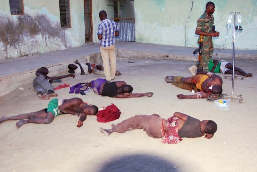 A handout picture released by the Nigerian army on July 28, 2013 shows Multinational Joint Task Force (MNJTF) medical officers treating on July 27, 2013 civilians injured by suspected members of the Boko Haram sect in the village of Dawashe, in  Borno.