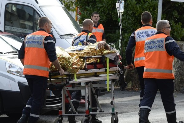 French firefighters wheel out the injured