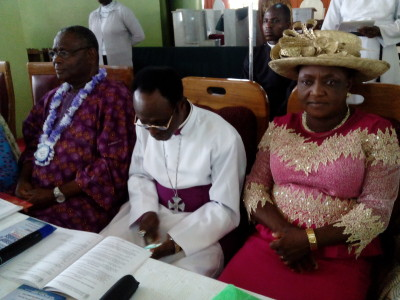 Diocese Bishop, Rt. Revd. Philip Adeyemo, flanked by his wife and a state government official