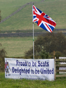 A pro-union banner and the British Union flag are pictured in a field near the Scottish borders, on September 11, 2014. The eyes of the world are on Scotland's referendum, pro-independence leader Alex Salmond said Thursday as a top bank warned it would re-register in England if the separatists win.  AFP PHOTO / LESLEY MARTIN