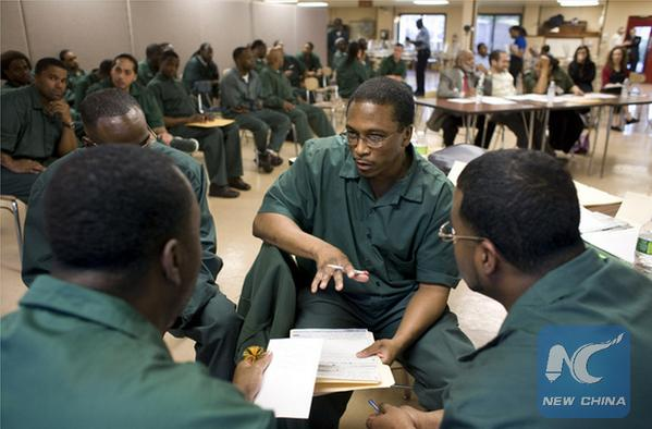 Andrew Cooper, an inmate, and his teammates in the debate. Photo: The New York Times/Brian Harkin