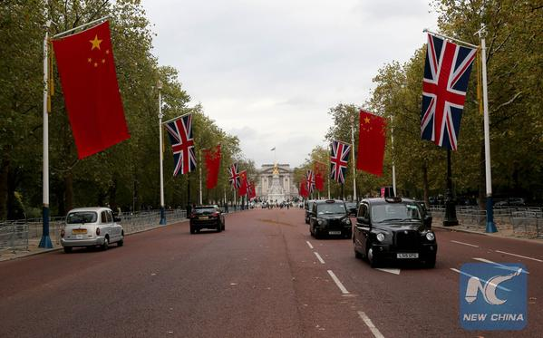 London getting ready: Chinese Flag side by side  with the British flag