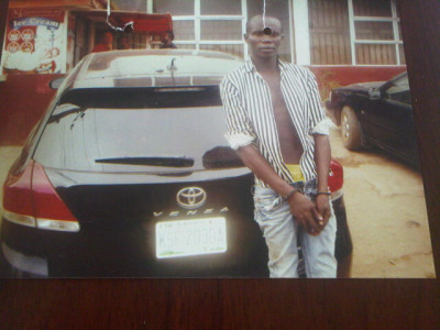 Car thief Somadina Enyiobi with the SUV he stole