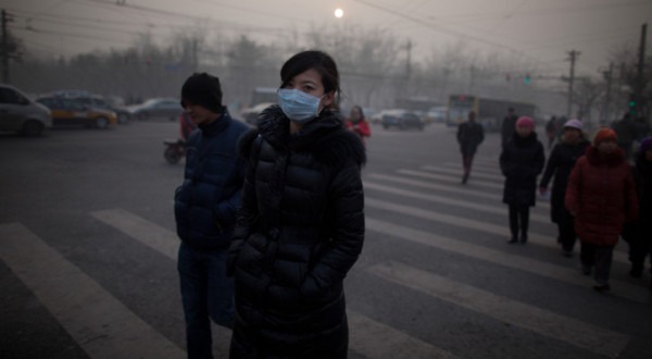 Residents of Beijing, wearing nose and mouth masks