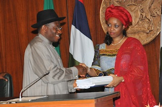 Diezani, right presenting a report to Goodluck Jonathan in 2012: both never fixed the refineries