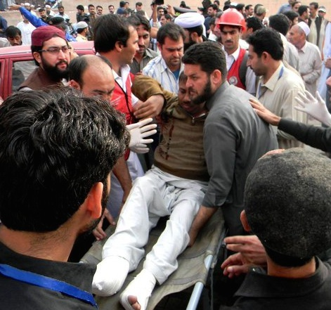 Pakistan earthquake: a man injured being rescued