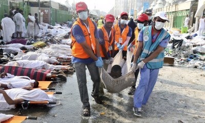 Rescue workers carry the body of a Muslim pilgrim after a stampede at Mina, outside the holy Muslim city of Mecca