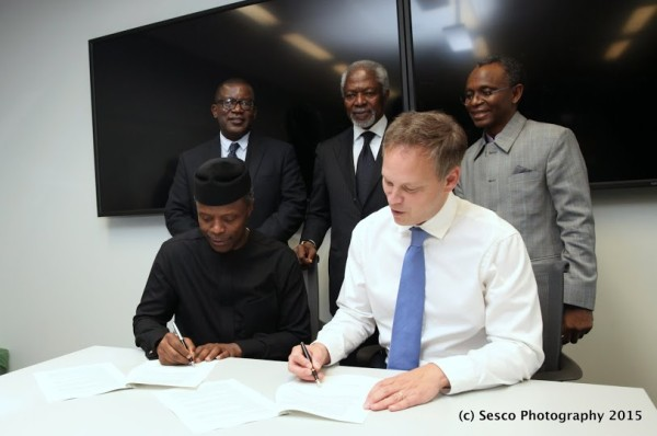 VP Osinbajo and the UK Minister of State for International Development, Mr Grant Shapps, sign the agreement
