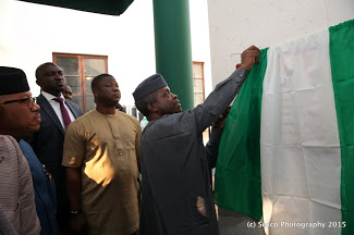 VP Osinbajo unveiling the plaque on the building