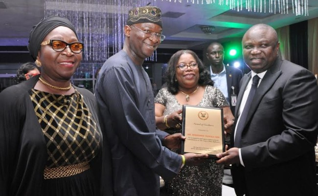 Lagos State Governor, Mr. Akinwunmi Ambode, with the Chief Judge of Lagos State, Hon. Justice Olufunmilayo Atilade, jointly presenting an award of Excellence to the former Lagos State Governor, Mr. Babatunde Fashola during the 2015/2016 Legal Year Dinner, at the Law School, Victoria Island, Lagos, on Friday. With them is Justice Toyin Oyekan-Abdullai.