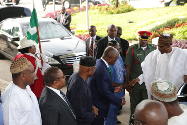 President Muhammadu Buhari in a hand shake with his  Special Assistant  on National Assembly matters, Senator Ita Enang, FCT Permanent Secretary, Chief John Chukwu and others  PHOTO; SUNDAY AGHAEZE.