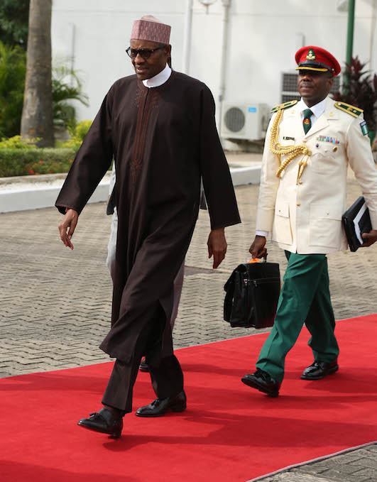 President Buhari moves to board the aircraft, on the way to India
