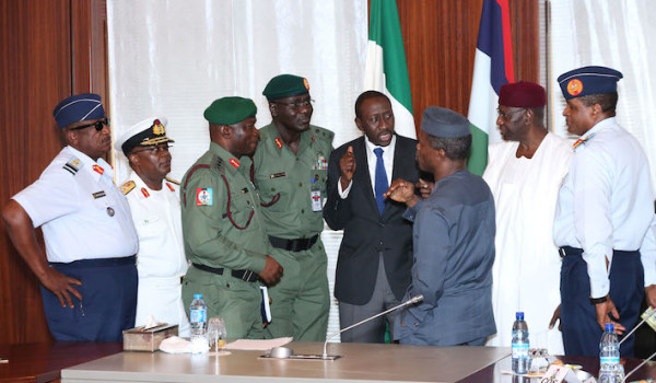 Vice President Yemi Osinbajo (M) confers with Chief of Air Staff, Air Marshal Sadique Abubakar , Chief of Staff, Mr Abba Kyari, NSA Major General Babagana Monguno, Chief of Army Staff, Lt General T.Y. Buratai, Chief of Naval Staff, Vice Admiral Ibok-Ete Ekwe Ibas, Chief of Defence Staff, General Abayomi Gabriel Olonisakin and Chief of Defence Intelligence, Air Vice Marshal Morgan Monday Riku after a Meeting with the President and the Service Chiefs at the State House in Abuja. PHOTO; SUNDAY AGHAEZE.