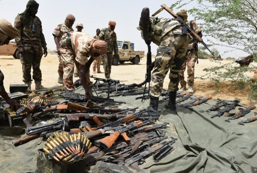 Chadian soldiers display arms captured from Boko Haram militants in Malam Fatori, in northeastern Nigeria