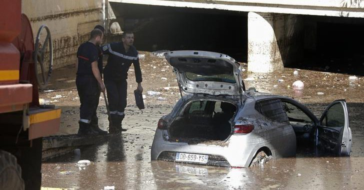 A car almost disappearing in flood