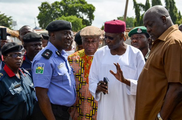 Abba Kyari speaks with the police chief at the scene
