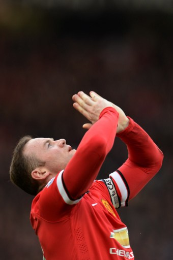 Manchester United's English striker Wayne Rooney out