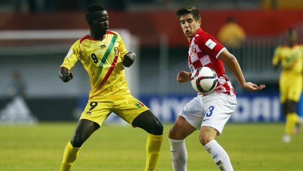 Mali's No 9 Malle, battle with a Croatian defender for the ball
