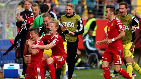Ecstasy: Belgian players rejoice after edging Mexico for third place