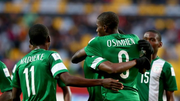 Victor Osimhen  being congratulated by team mates after opening scoring