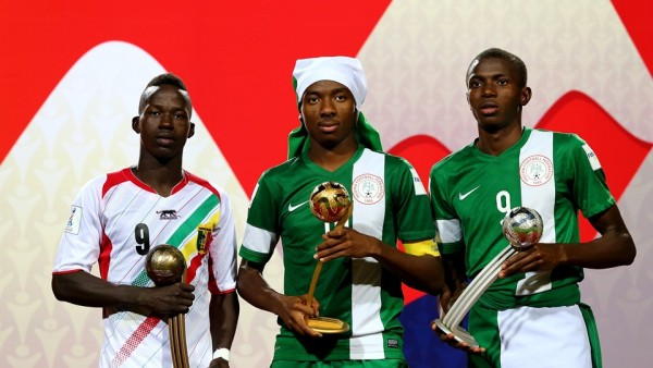 Kelechi Nwakali (C) of Nigeria, winner of the adidas Golden Ball, poses with Victor Osimhen of Nigeria (R, adidas Silver Ball) and Aly Malle of Mali (L, adidas Bronze Ball) after the FIFA U-17 Men's World Cup 2015 final
