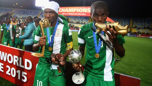 Adidas Golden Ball winner Kelechi Nwakali (L) and adidas Golden Boot and Silver Ball winner Victor Osimhen pose with their trophies