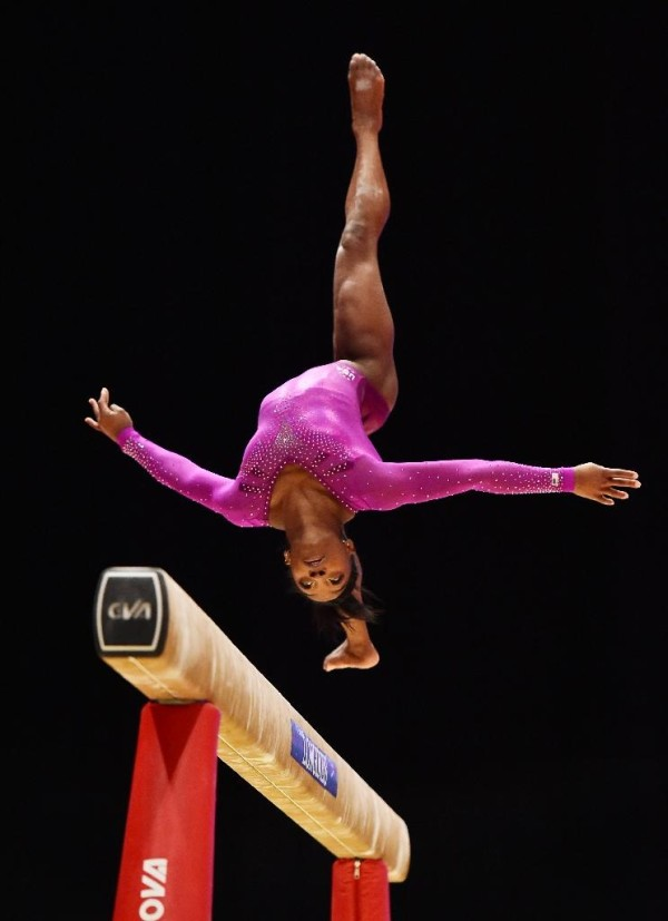 Simone Biles: scored 15.358 to take the balance beam title by a 1.025 margin on Sanne Wevers (AFP