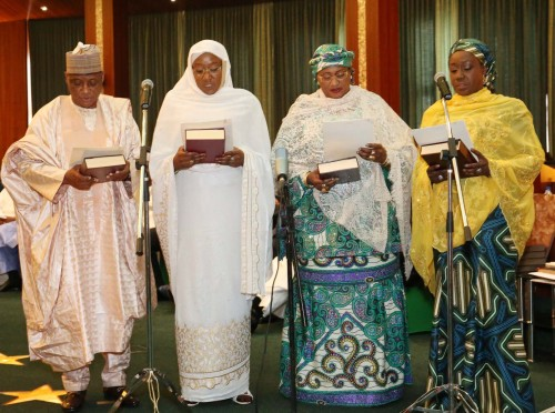 Aisha Alhassan, a k.a Mama Taraba, second right, takes the oath with other female ministers