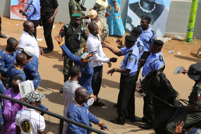 Area boys with policemen at the event. Photo Credit Idowu Ogunleye