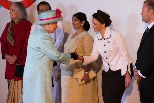 Queen Elizabeth II being welcome to the summit by wife of Malta PM Muscat