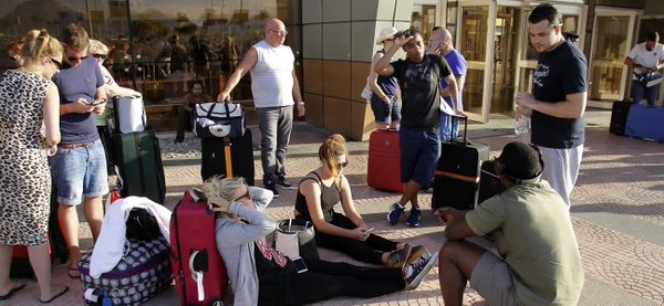 Home bound: British tourists troop out of Egypt