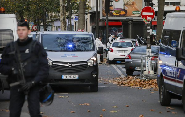 An armed policeman outside the concert hall where over 80 people were killed