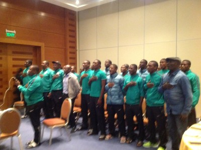 Members of Nigeria's Golden Eaglets listening to President Muhammdu Buhari during a live chat with the team via telephone Saturday.