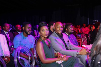 Genevieve, left and Kunle afolayan, right of front of front seat