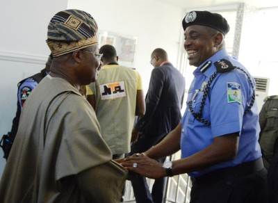 Governor Abiola Ajimobi welcoming  the IGP, Solomon Arase,, to his office