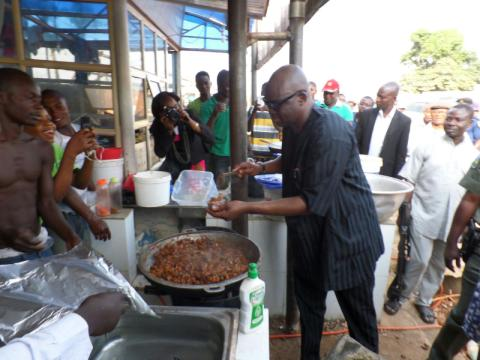 Fayose buying cooked goat meat
