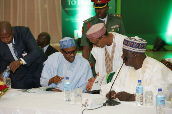 President Buhari discusses with Dr Baba Ahmed and Secretary to government, Babachir David Lawal