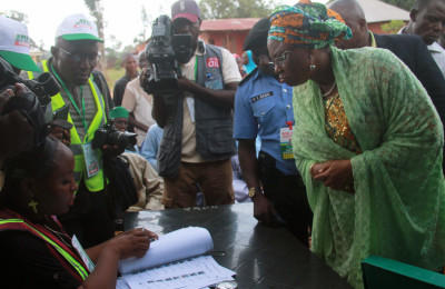 Mrs Halima Wada, wife the governor is search of her name on the voting list (3)