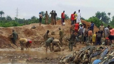 Nigerians scavenging for the contaminated chicken