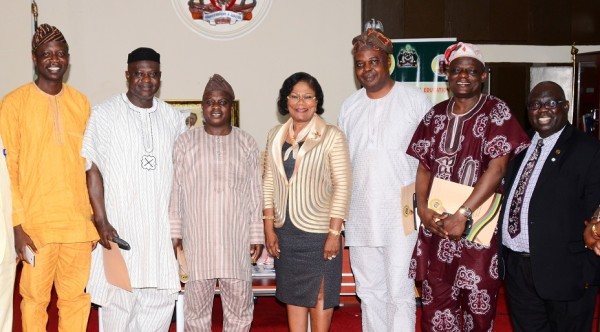 Deputy Governor State of Osun, Mrs Titi-Laoye Tomori (centre); Chairman, Osun House of Assembly Committee on Education, Folorunso Oladoyin (3rd right); Deputy Chairman of the committee, Abiodun Awolola (3rd left); Chairman House Committee on Information and Strategy, Olatunbosun Oyintiloye (left); Permanent Secretary, Ministry of Education, Lawrence Oyeniran (right); Members - Leke Ogunsola (2nd right) and Musibau Azeez (2nd left), during a visit to the Deputy Governor in her office.