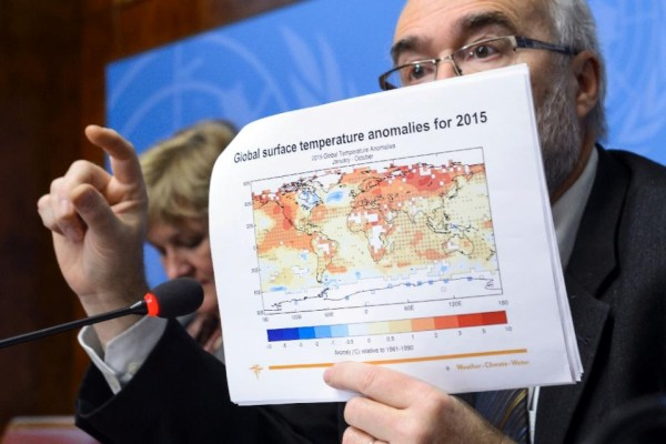 Secretary-General of the World Meteorological Organization Michel Jarraud shows a document on global surface temperature anomalies for 2015 on November 25, 2015 in Geneva (AFP Photo