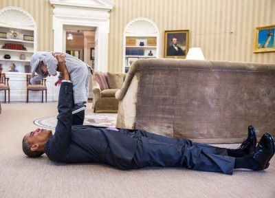 President Obama playing with a baby