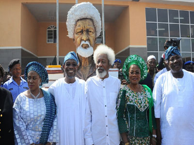 Wole soyinka with his trademark white hair in the middle with Governor Aregbesola, his wife and others