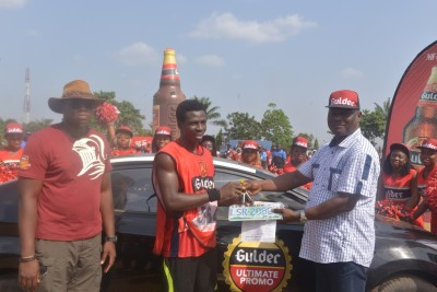 L – R: Onyeka Okoli, Senior Brand Manager – Gulder, Nigerian Breweries Plc; Esedi Joe David, winner of a brand new Hyundai Elantra car and Patrick Ejidoh, Public Affairs Manager – East, also of Nigerian Breweries Plc., at the presentation of the grand prize to the winner of the Onitsha leg of the Gulder Ultimate Chase at the Achebe Stadium, Onitsha on Saturday, November 21