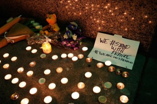 Paris attacks: candle lit for the dead